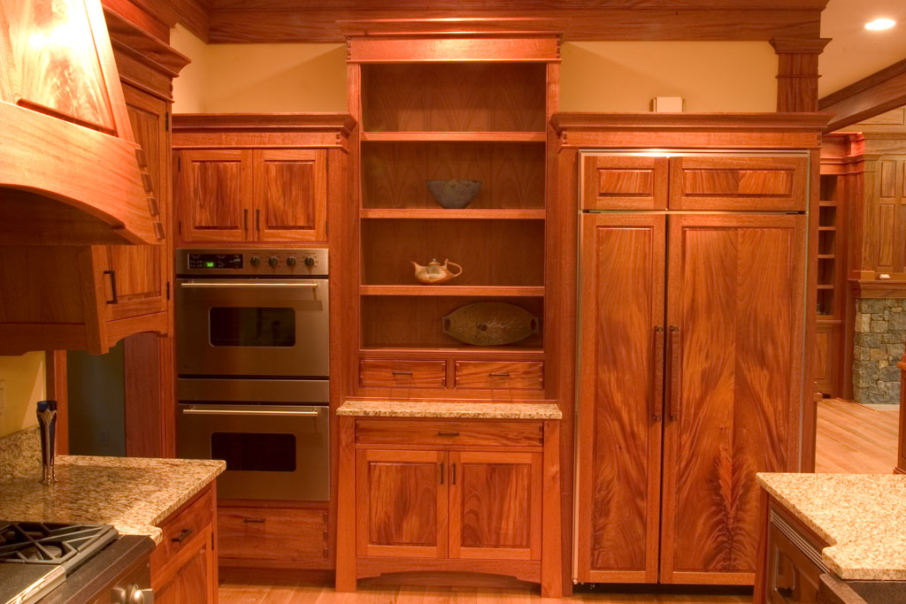 The final wall is the oven cabinet, built in refrigerator and a display cabinet. Continued use of bookmatched sets finishes out our Artisan Kitchen.
