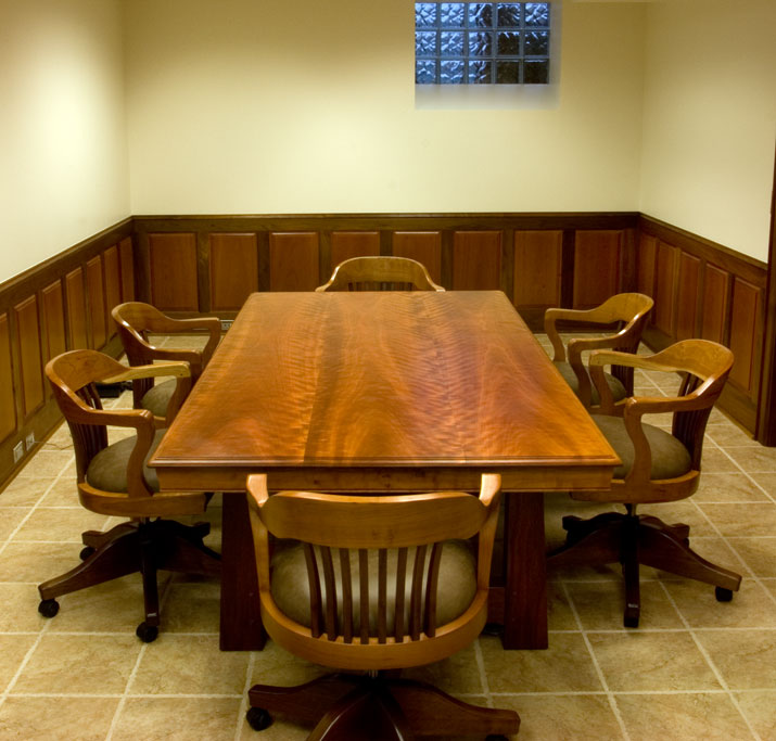 This conference table is 4' x 8' and executed in figured cherry and walnut.  The chairs were commissioned to match.