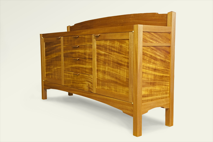 A sideboard made from one strongly grained plank of mahogany. Door and drawer pulls from end grain mahogany.
