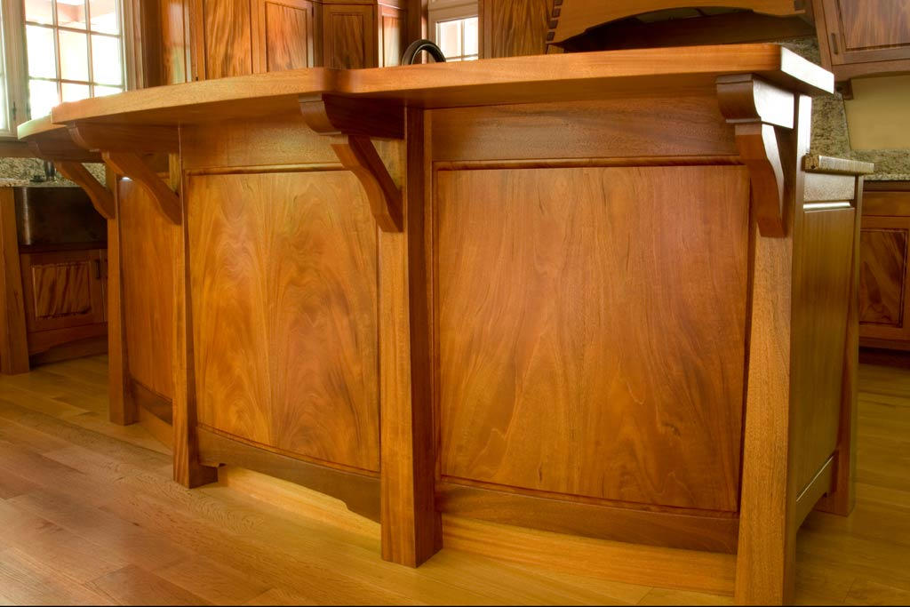 Whenever we have a client that wants kitchen furniture instead of cabinets, we pull out our best materials. This Peruvian mahogany features some beautiful curved panels of bookmatched material.