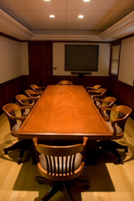 "The mahogany and wenge confrence room furniture consists of a 48"" x 144"" solid table with ten mahogany and wenge (WEN.gay) rolling chairs with hand picked leather hides."